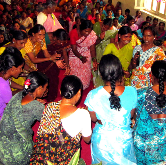 Women participants of the Family Development Program in Hyderabad, Andra Pradesh celebrate their strengths and success through song and dance at an Annual Family Gathering.