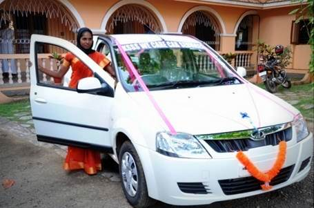 Mrs. Sheela with her new taxi